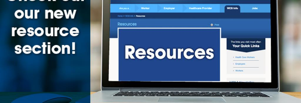 """An image of a laptop on a wood desk. The laptop is displaying the Resources page of the WCB website. The left side of the image is covered by a dark blue screen with the words """"Check out our new resource section!"""""""